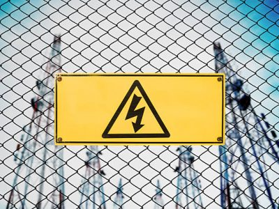 High Voltage Sign and Symbol Caution Signboard on Fence Wire at Electrical Power Plant Station